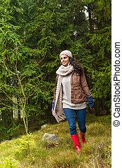 Happy woman relaxing in the forest