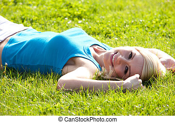 Happy woman relaxing in the sun