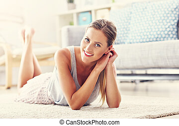 Happy woman resting at home
