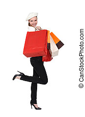 Happy woman returning from shopping trip