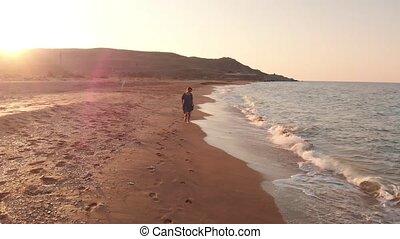 Happy woman run at the beach