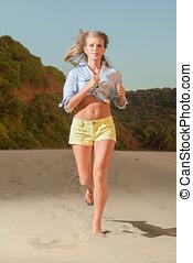 Happy woman run on beach