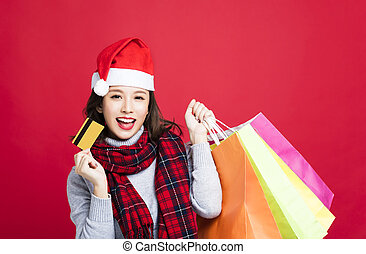 happy Woman shopping for christmas gifts by credit card