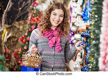 Happy Woman Shopping For Christmas Ornaments
