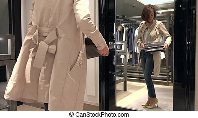 Happy Woman Shopping For Leather Bag And Looking At Mirror