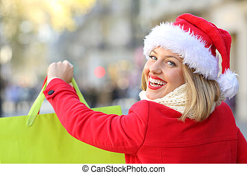 Happy woman shopping in christmas