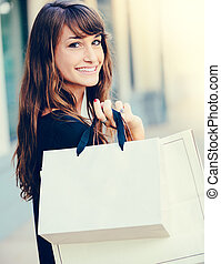 Happy Woman Shopping - Happy woman holding shopping bags and...