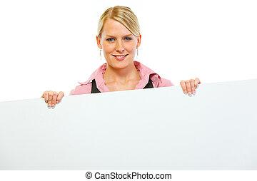 Happy woman showing blank billboard