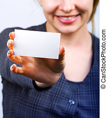 Happy woman showing blank business card