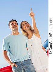 Happy woman showing something to her handsome boyfriend