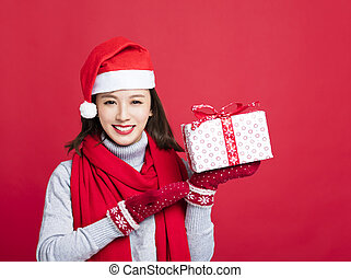 happy Woman showing the christmas gift