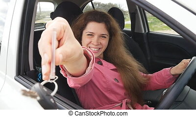 Happy Woman Showing The Key Of New Car