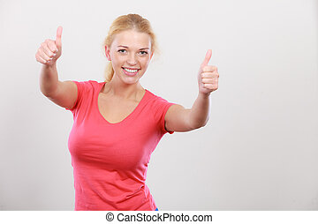 Happy woman showing thumbs up gesture