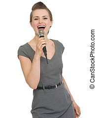 Happy woman singing in microphone isolated - Happy woman...
