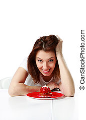 Happy woman sitting at the table with fresh strawberry cake isolated on a white background