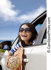 happy woman Sitting In Car and looking back