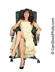 happy woman sitting on armchair