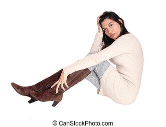 Happy woman sitting on the floor.