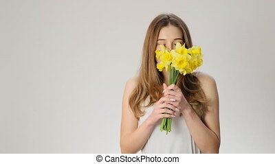 Happy woman smells flowers and smiles slow motion - Happy...