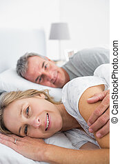 Happy woman smiling at camera with husband