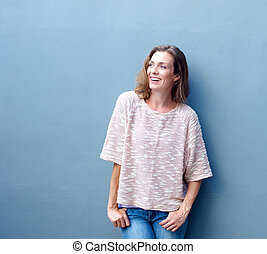Happy woman smiling on gray background