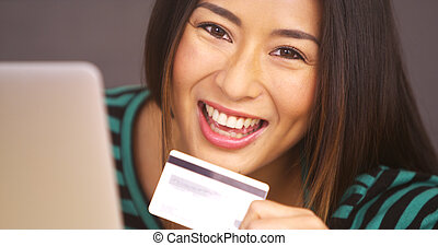 Happy woman smiling with card in hand