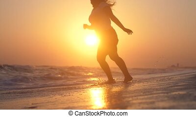Happy woman spinnin enjoying nature dancing on beach at...