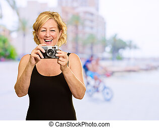 Happy Woman Standing With Photo Camera