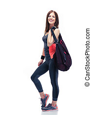 Happy woman standing with sports bag