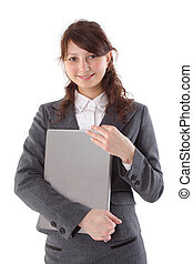 happy woman student holding a laptop isolated on white