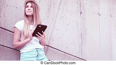 happy woman student holding a tablet