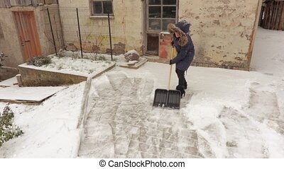 Happy woman take fun and removing snow