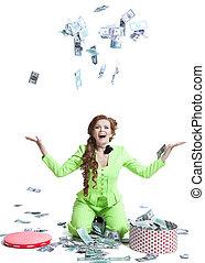 Happy woman throwing money