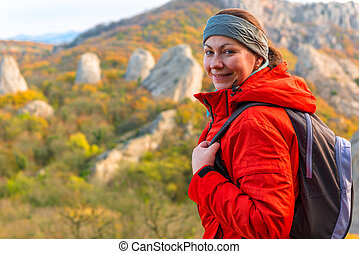 Happy woman tourist portrait in the autumn mountains