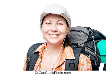 happy woman tourist with a backpack on a white background