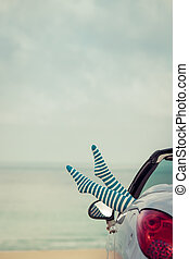 Happy woman travel by car to the sea. Girl having fun in...