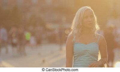 Happy woman traveler walking in Milan