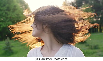 Happy woman turns the head and hair. slow motion
