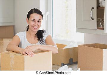 Happy woman unpacking