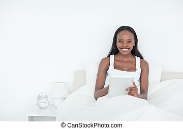 Happy woman using a tablet computer