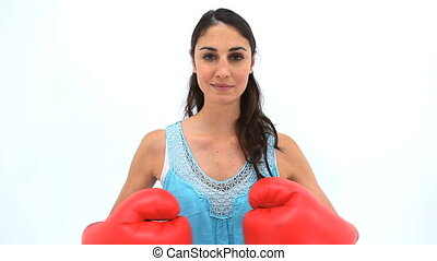 Happy woman using boxing gloves