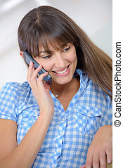 happy woman using phone