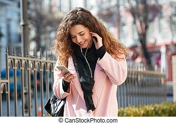 Happy woman using phone