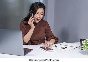 woman using smartphone and digital tablet to online shopping