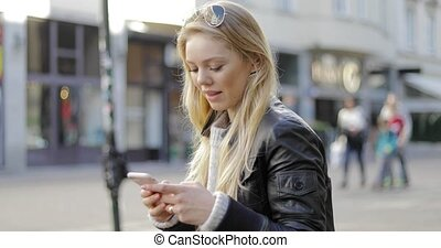 Happy woman using smartphone