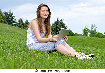 Happy woman using touchpad tablet
