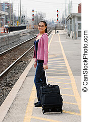 Happy woman waiting for a train