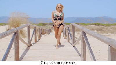 Happy Woman Walking at the Beach Pathway - Full Length Shot...