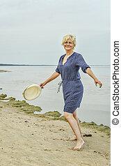 happy woman walking near the sea