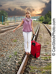 Happy woman   walking on rail